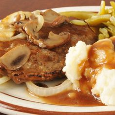 Here is an old time classic. Liver and onions with gravy and in this recipe we included mushrooms. This meal should be served with mashed potatoes. Liver And Onions With Gravy Recipe from Grandmothers Kitchen. Onion Recipes, Meat Recipes, Cooking Recipes, Liver And Onions With Gravy Recipe, Beef Dishes, Food Dishes, Main Dishes, Liver Recipes, Salisbury Steak Recipes