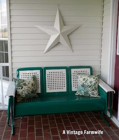 Would love to have a vintage metal porch glider someday...my aunt had one and I loved it.
