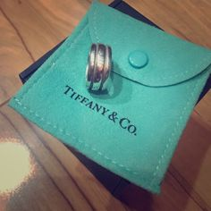 Tiffany and Co. Atlas wide ring preowned,comes with pouch.Size 5 Tiffany & Co. Jewelry Rings