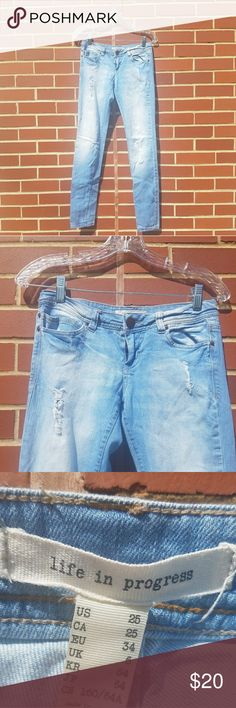 NWOT Light Blue Faded Distressed Jeans So cute. Never worn. Size 25. No stains or imperfections. Forever 21 Jeans
