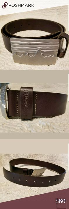 """NWOT Patagonia Brown Belt 100% Leather Fitz Roy 30 NWOT Patagonia Dark Brown Belt - hard to find 100% Leather  Fitz Roy Buckle Size 30 28"""" from belt hook to 1st hole 34"""" from belt hook to 1st hole Please contact me with any questions Smoke-free home Thanks for looking! Patagonia Accessories Belts"""