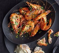 Spicy seafood is a really versatile dish for sharing - make sure there's plenty of bread for the juices