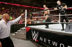 Triple  H facing Randy Orton  and Sting