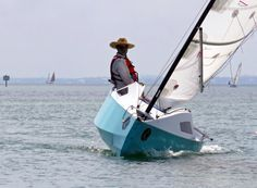 When the breeze picks up, up to 160 lbs of water can be pumped into the windward ballast tank to help counter heeling. Kayak Boats, Fishing Boats, Fishing Boat Accessories, Sail Racing, Small Sailboats, Sailing Catamaran, Honfleur, Wooden Boat Building, Build Your Own Boat