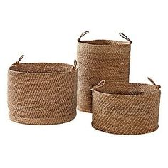 """<p>A chunky weave and looped, knotted handles give these baskets an unstructured, beachy feel that relaxes a room instantly. We love them for everything, from towels to toys. The tallest is perfect as a laundry hamper.<span style=""""line-height:1.6em"""">Handwoven of sustainable seagrass.</span></p><p>Basket Sizes:</p><p>Short: 18"""" DIAM x 11"""" H.</p><p>Medium: 19"""" DIAM x 15"""" H.</p><p>Tall: 17"""" DIAM x 21"""" H. Handles, 5"""" DIAM.</p>"""