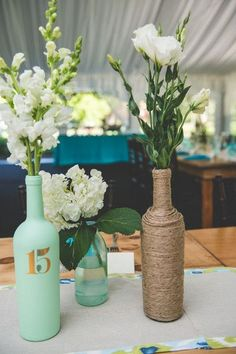 rustic mint wedding centerpieces with wine wrapped bottle / http://www.himisspuff.com/rustic-wedding-centerpiece-ideas/5/
