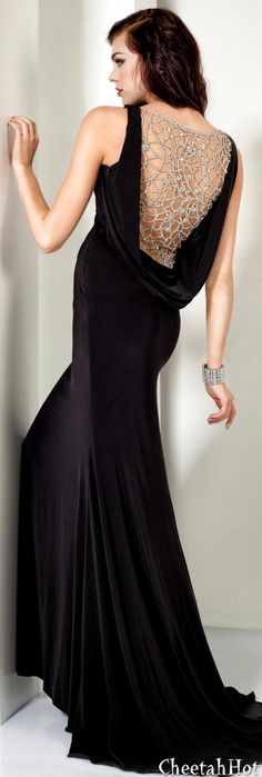 Love the drape and the added glamour of the back piece    JOVANI - Knot Black Gown