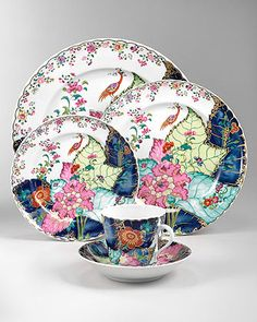 Mottahedeh Tobacco Leaf Dinnerware: Tobacco Leaf, one of the most prized of Chinese Export patterns, was developed circa 1780, probably for the Portuguese and Brazilian markets - though examples have also been found in other European countries and in North America. The design shows the leaves of the flowering Nicotiana (Tobacco) plant upon which a small phoenix perches bearing a flowering twig in its beak. This exact reproduction requires twenty-eight colors including 22K gold and five firings …