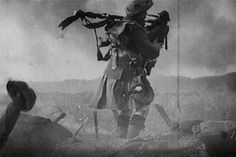 Scottish piper in a Kilt on the battlefield during World War One