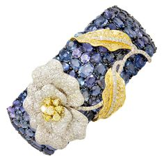 Incredible Wrapped Flower Sapphire Diamond Flower Cuff, with carats of blue sapphires, carats of white diamonds, and carats of yellow diamonds, set in gold. Gems Jewelry, I Love Jewelry, Jewelry Art, Vintage Jewelry, Fine Jewelry, Jewelry Design, Unique Jewelry, Jewelry King, Cuff Jewelry