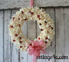 Popcorn and Cranberry Wreath - This wreath is so, so simple! If you like the look of popcorn garland on the tree but have dogs that would help themselves to the…