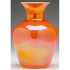 Imperial vase, shouldered form in orange glass with surface iridescence