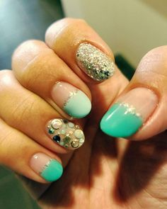 Precious Stones From The Summer Seabed On Aqua And Golden Glitter Polish Over Negative Space For Oval Nails