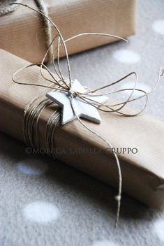 Christmas simple gift wrapping. Brown paper; bakers twine and stars.