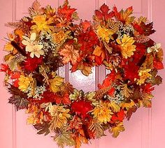 Google Image Result for http://www.artificialchristmaswreaths.com/heart_of_mums_fall_wreath45.jpg