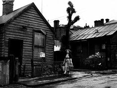 A woman carries water towards Woodman house in Griffen Crescent, North Melbourne. Melbourne Docklands, West Melbourne, Melbourne Suburbs, Melbourne Victoria, Victoria Australia, Melbourne Australia, Tin Shed, The 'burbs, Australian Homes