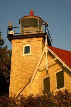 The Eagle Bluff Lighthouse in Fish Creek, Wisconsin is one of Door Counties 13 lighthouses. Door County was featured in the Winter 2011 issue of American Road. Find Wisconsin fun  with the free App: http://dld.bz/travelWIApp