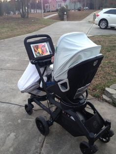 orbit baby stroller has a place for your iPad! Ohhhh wowwwww yes I really need this for my next kid... Love this