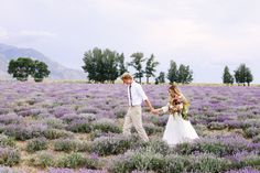 I really like this shot with them holding hands and him leading through the beautiful field!