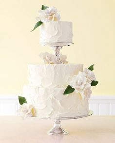 Buttercream wedding cake. See our post on buttercream cakes at http://tulleandtwine.com/2013/9/3/beautiful-buttercream