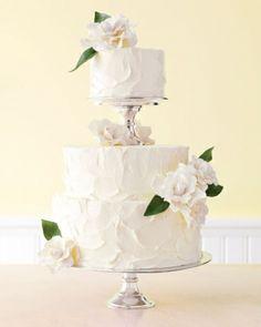 Buttercream wedding cake topped with gum paste gardenias
