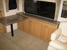 Table can be positioned towards the rear to allow open walkway while slide room is in. The Longest Journey, Rv Parts, Corner Desk, Rv Remodeling, Kitchen Cabinets, Walkway, Room, Furniture, Table