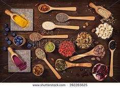 Super foods in spoons and bowls on a wooden background - stock photo