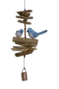 Bluebird Family Folk Art Finish Bell. Cohasset Bells are made by the same Balinese artists that craft our bamboo wind chimes. They select the perfect combination of driftwood, windfall (which is collected by village fisherman) and beads to complement the beautiful carvings. Beautifully hand crafted pair of wooden Bluebirds on a Cohasset Bell. This gift is sure to please any bird fancier. $44.41