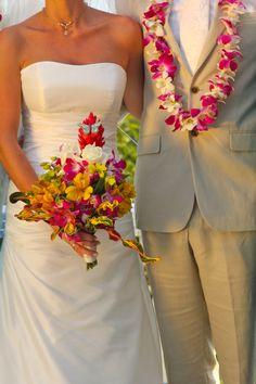 tropical orchid bouquet & lei for the bride and groom by Nosara Weddings & Events www.NosaraWeddingsEvents.com