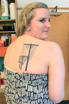 Bosch's first tattoo, power lines, are to remind her of her home in South