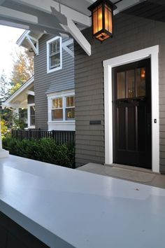 Medium-dark gray with white trim + black door. Notice the detail of the trim above the door.