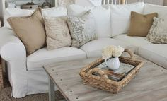White slip covered sofa.