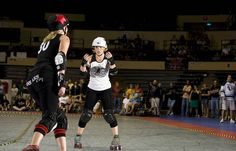 Cincinnati's Sadistic Sadie doing what she does best, pictured with Hall Balls of Kansas City. Photo by Phil Peterson.