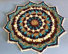 This colorful Mandala pattern is presented as a tutorial. In the making of this mandala you will be taken on an adventurous journey of how to read crochet charts. The tutorial is broken down into steps, showing each round of the chart separately. There are step by step instructions on how to interpret the chart symbols, with directions and hints on the placement of the stitches for each round. There are also photos of each finished round to help with stitch placement. Any yarn may be used…