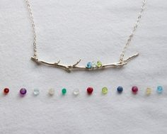 This unique twist on a family tree necklace is made of a real tree branch that has been cast in sterling silver. Up to 6 birthstones are wire wrapped to represent your children, grandchildren, or other loved ones.