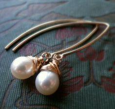 Pearl earrings, gold filled, bridesmaid gifts, wire wrapped pearls, modern pearl earrings, long, dangle, leaf shape hooks. $35.00, via Etsy.