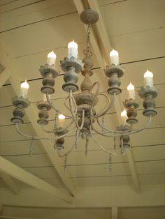She did a different finish on the chandelier, which originally was wood and metal.  http://relovedrubbish.blogspot.com/2011/03/old-world-chandelier.html