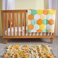A commissioned modern baby crib in solid Cherry. Inspiration was found in mid-century modern styled furniture, and modern cribs. The theme of the room…