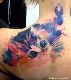 A cute watercolor kitty tattoo idea for woman's shoulder blade.