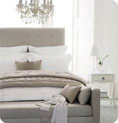 White, neutrals and grey colour palette for the master bedroom.