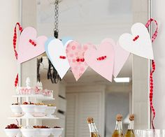 Paper Heart Garland at BHG.com.  Cute and easy decoration for my hearth.