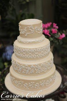 Wedding Cake...I like the beige background with white detailing. nice.