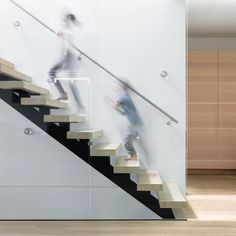 STAIR DESIGN - These wood and steel stairs feature a transparent glass balustrade and open risers, all of which let the light from the skylight above to flow through the space. Modern Staircase, Staircase Design, House Staircase, Stair Design, Staircases, Home Design, Interior Design, Interior Photo, Interior Stairs