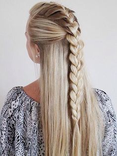 Easy mermaid braid; Section out the top portion of hair and secure in a clip. Next pull half section back. Begin to braid hair that was previously sectioned out and combine with the second portion.