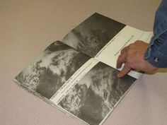 Phil Laramore flips through a book showing some of the devastation of the April 10, 1979, tornado. More than 30 years later, the tornado's i...