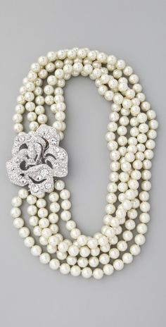 Kenneth Jay Lane Pearl & Crystal Necklace.  I can make something similar with a broach