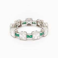 Art Deco Square Cut Diamond & Greem Emerald Eternity Band - Ladies Platinum 1930's Art Deco eternity band featuring (9) square-cut diamonds weighing