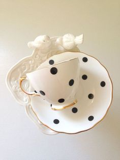 polka dot black and white tea cup and saucer