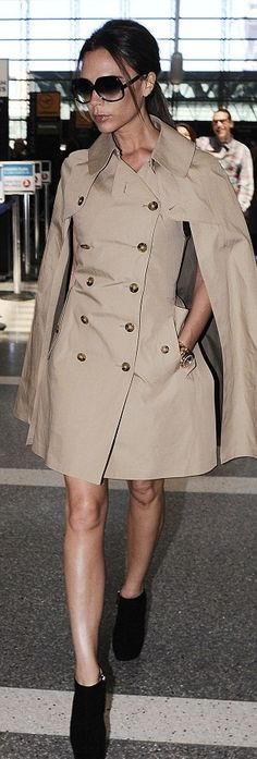 victoria beckham dons cape style trench coat