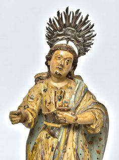 Imagem de Santa Luzia entalhada em madeira, policroma e dourada. Minas Gerais, último terço do século XVIII. De acordo com Erick Marques Ferreira, esta imagem é de autoria de mestre Valentim Correa Paes.